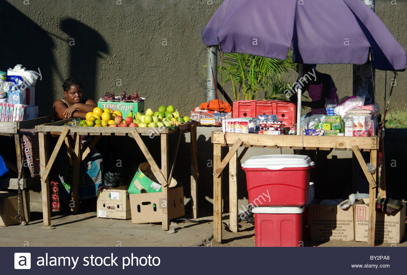 Shopping in Maputo Mozambique Africa - street marker fruits seller fresh fruits stall stalls Stock Photo
