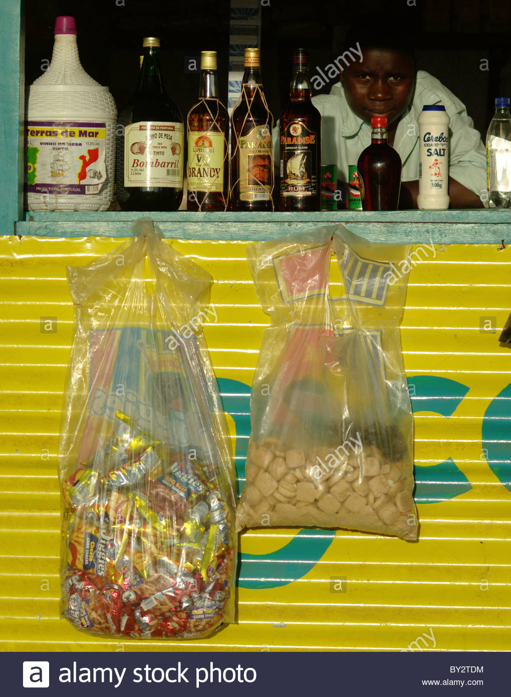 Muslim Boy Selling Alcohol And Cell Phone Recharge Shop - Mozambique Southern Africa - Stock Image