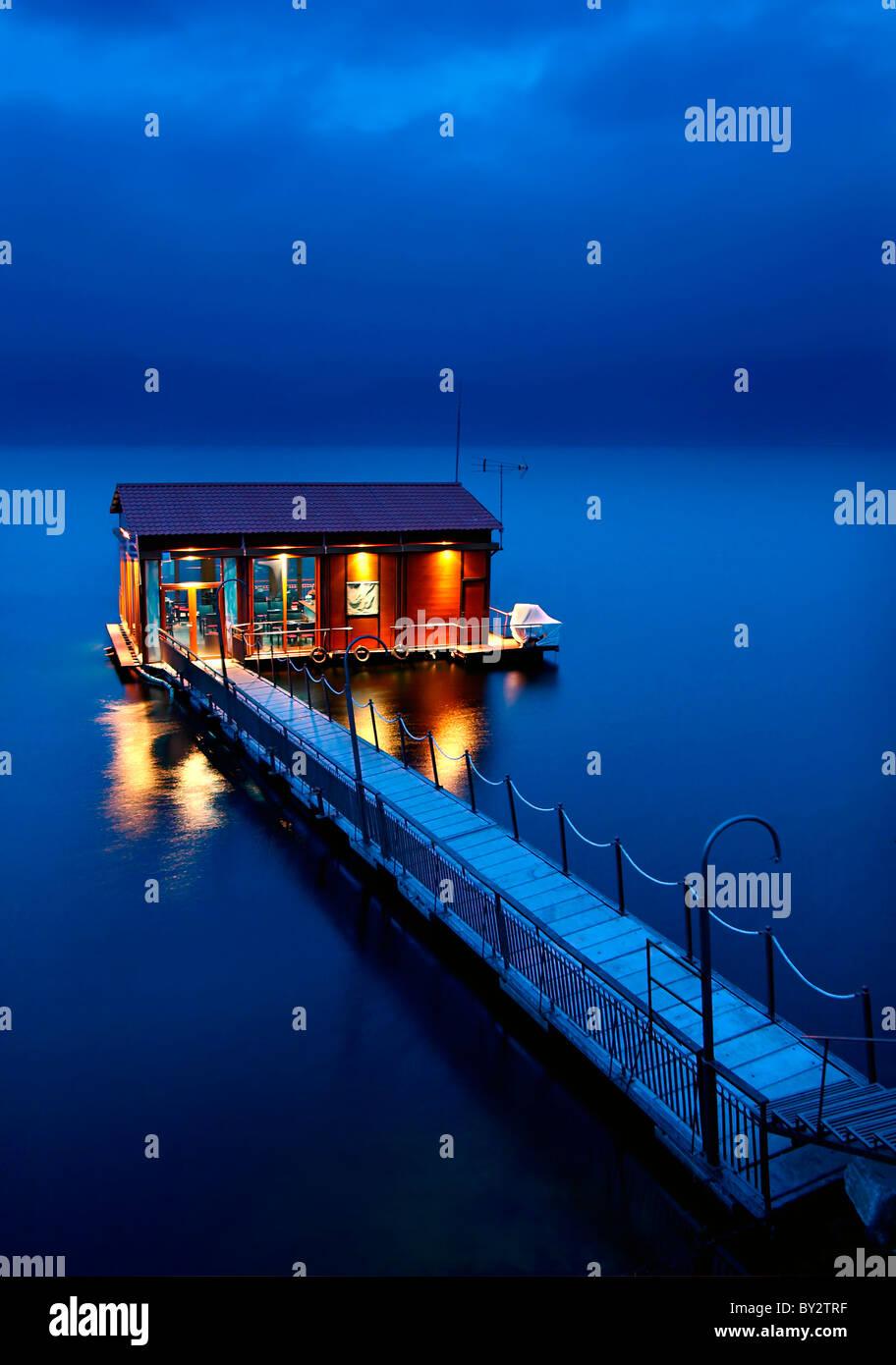 A floating bar in Lake Vegoritis (or 'Vegoritida'), close to Arnissa town, in Pella prefecture, Macedonia, - Stock Image