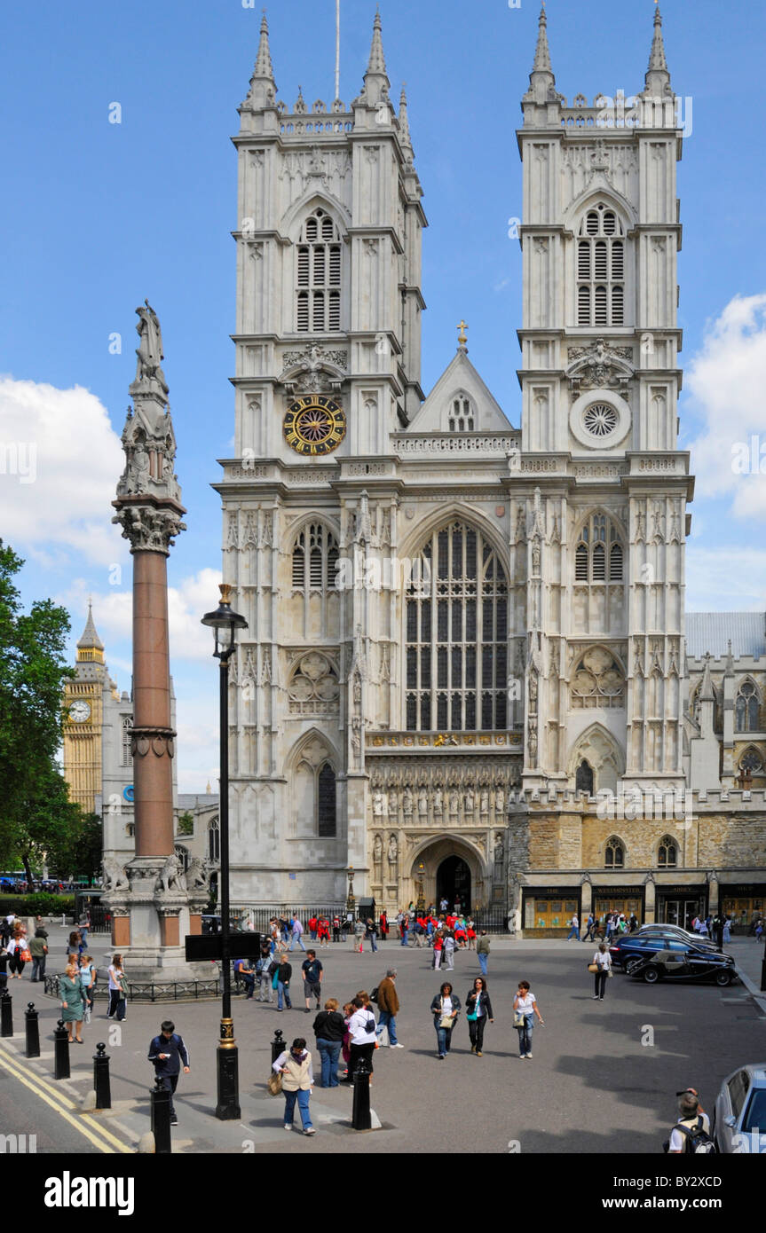 Looking down on tourists outside Portland stone towers West front of famous historical Westminster Abbey London - Stock Image
