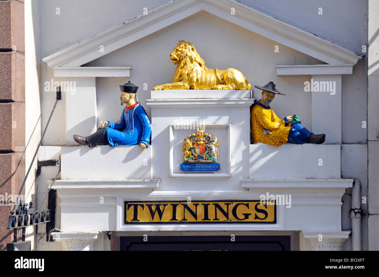 Colourful close up of sign and Royal Warrant above Old Twinings Tea Shop (brand owned by Associated British Foods) - Stock Image