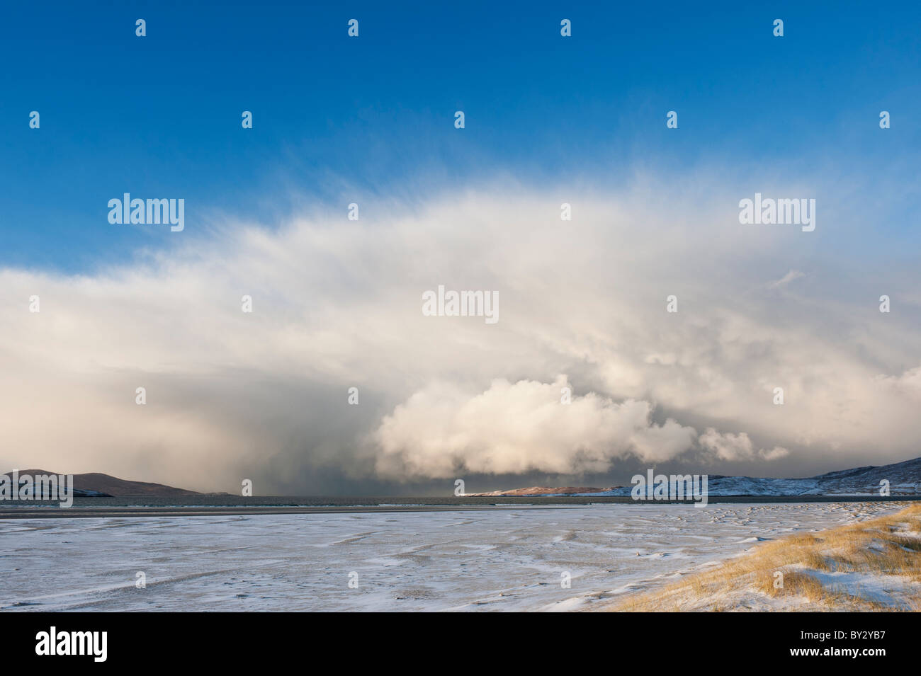 Dramatic clouds of approaching winter snow squall over Luskentyre beach, Isle of Harris, Outer Hebrides, Scotland Stock Photo