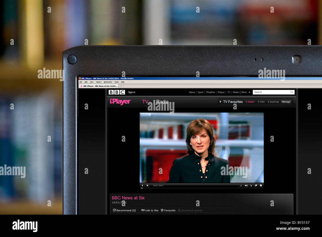 Watching the evening news on the BBC iPlayer, UK - Stock Image
