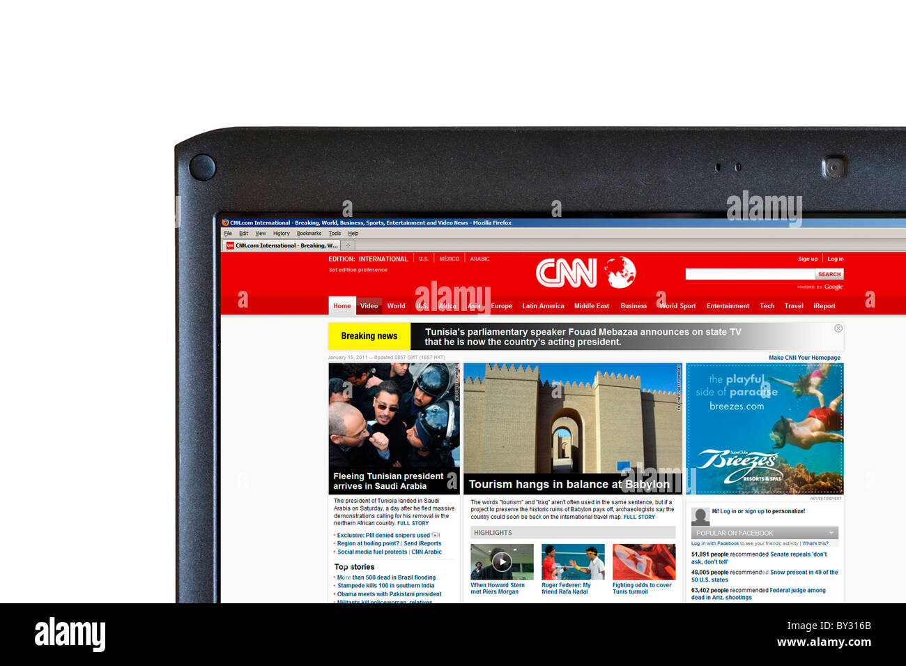 Browsing the CNN International News website on a Laptop