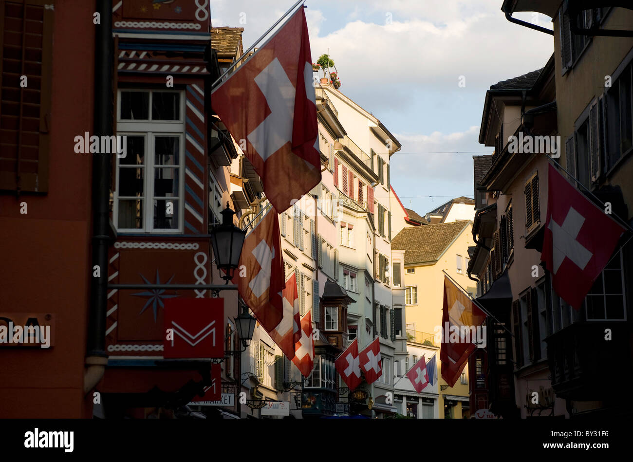 Swiss flags in the Augustinergasse, Zurich, Switzerland - Stock Image