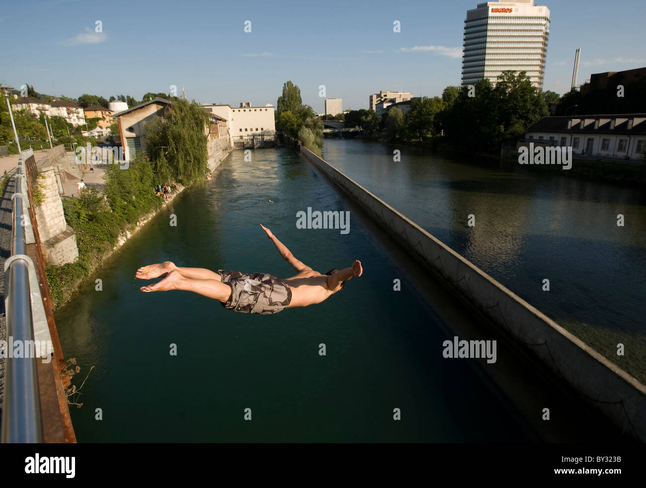 Jumping into the Limmat River in Lower Letten bathing place, Zurich, Switzerland - Stock Image