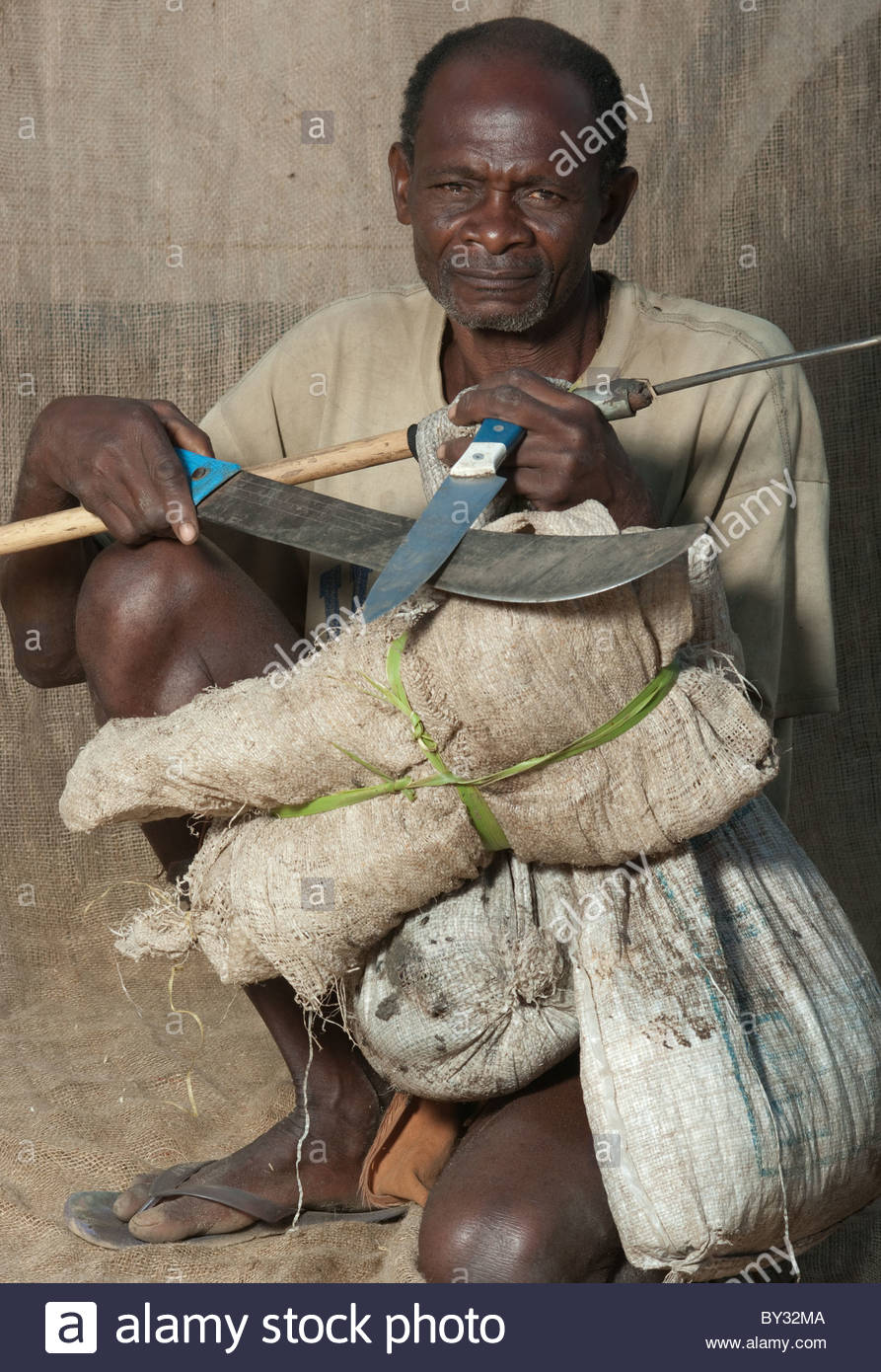Portrait of old Muslim African Man by explorer Kypros - Mozambique Africa - Prawn fisherman with fishing spear Stock Photo