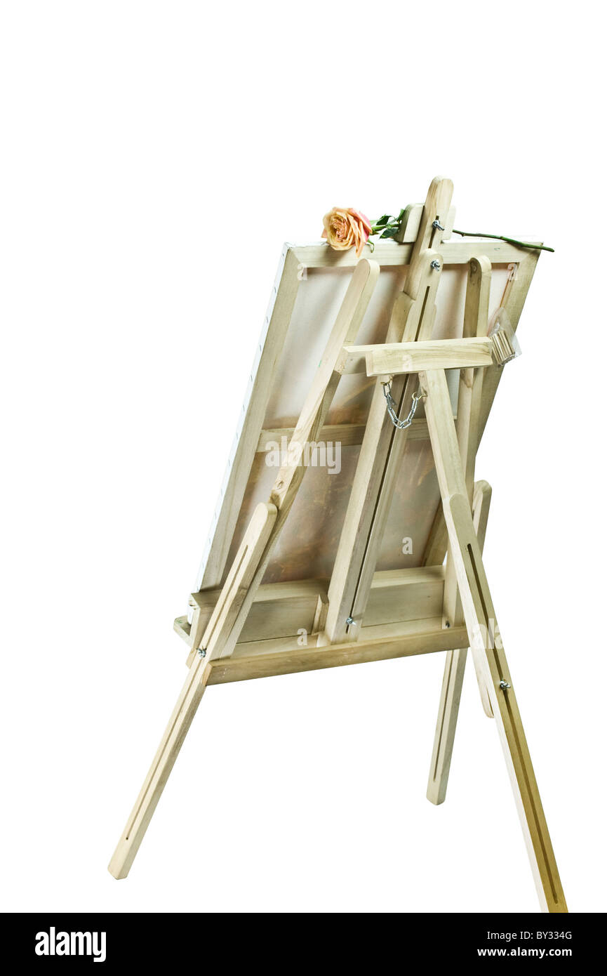 Empty blank canvas on the wooden easel - Stock Image