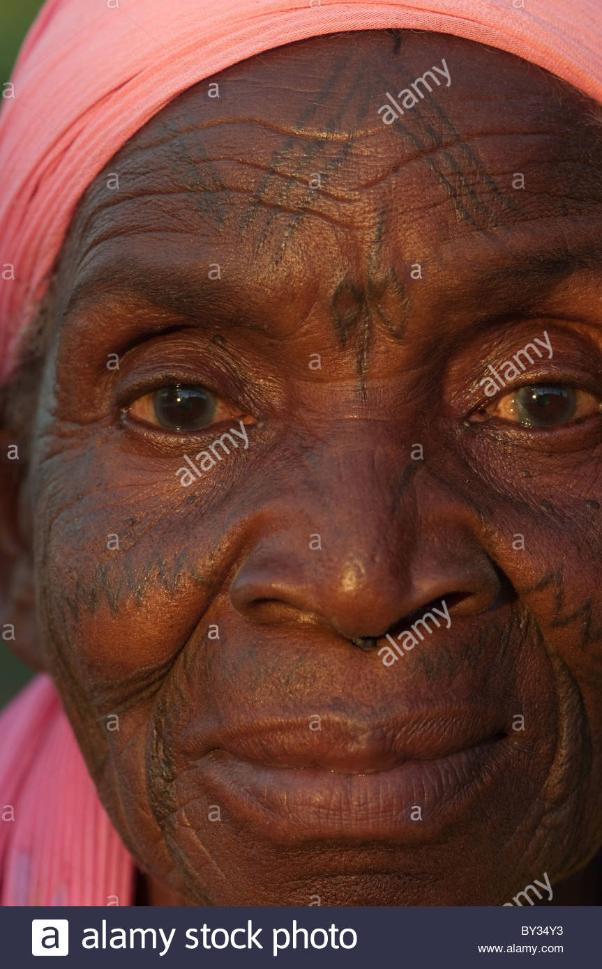 Portrait of old Muslim African woman by explorer Kypros - Mozambique Africa - facial tattoo tattoos tattoo's Stock Photo