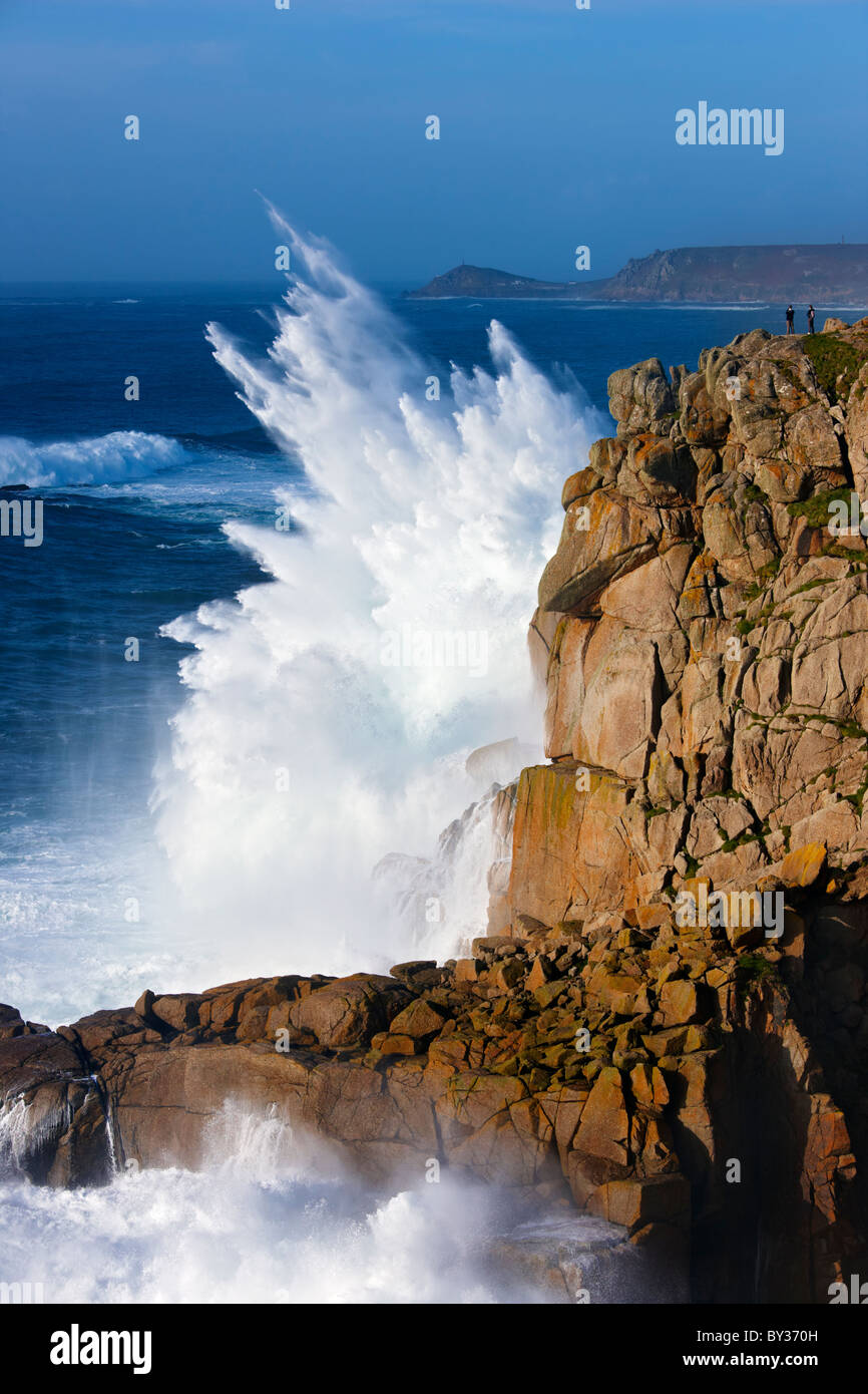 Huge waves crash on to the Cornish coast smashing against the cliffs near to Land's End - Stock Image