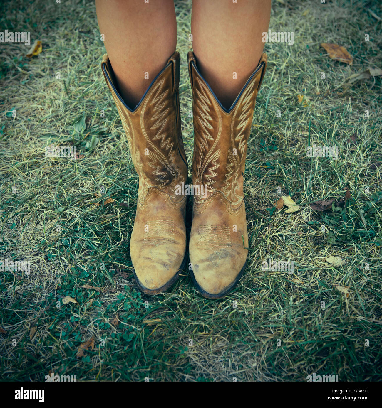 Woman Wearing Cowboy Boots On Stock Photos & Woman Wearing ...