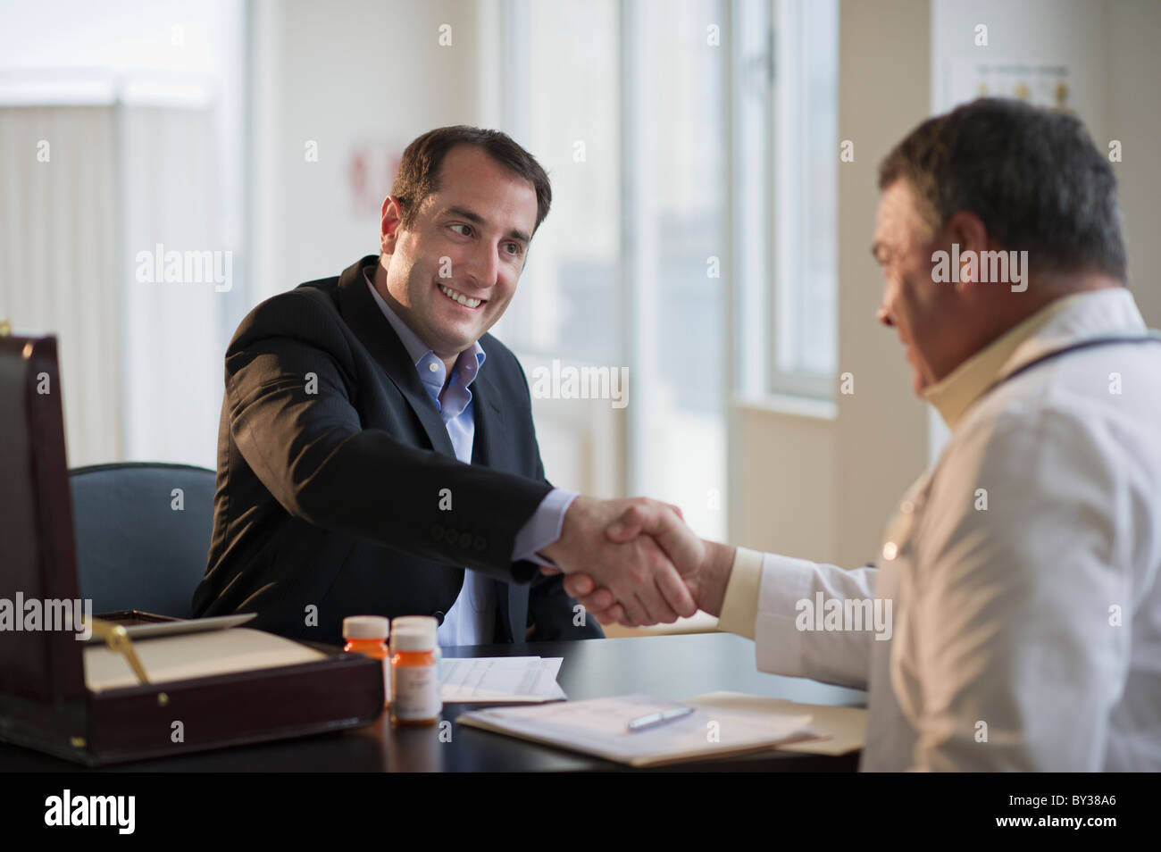 USA, New Jersey, Jersey City, Medical Sales Representative Shaking Hands  With Doctor In