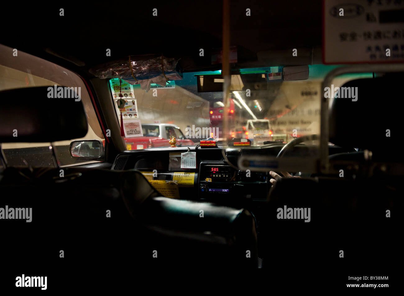 View Through a Taxicab Windscreen in the Cross Harbor Tunnel Passing from Hong Kong Island to Kowloon - Stock Image