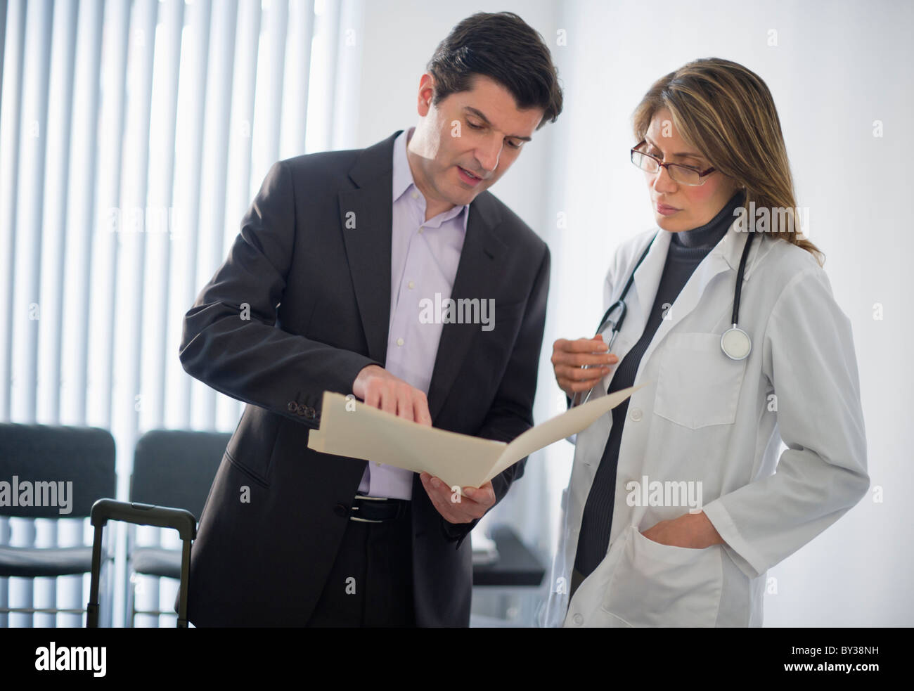 Delightful USA, New Jersey, Jersey City, Medical Sales Representative Talking With  Female Doctor In