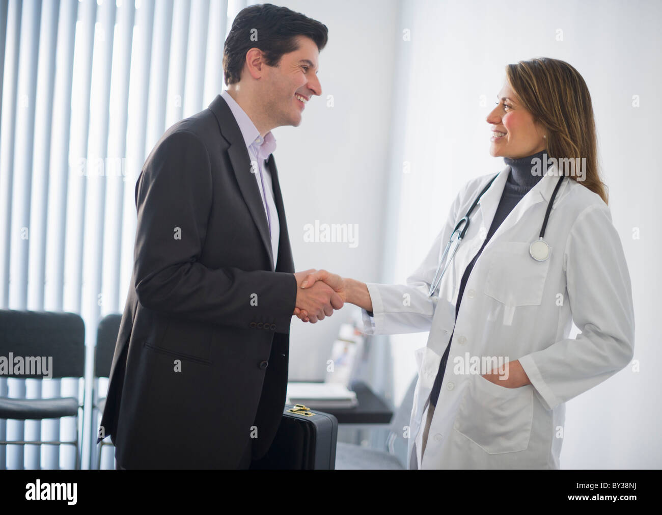 Elegant USA, New Jersey, Jersey City, Medical Sales Representative Shaking Hands  With Female Doctor