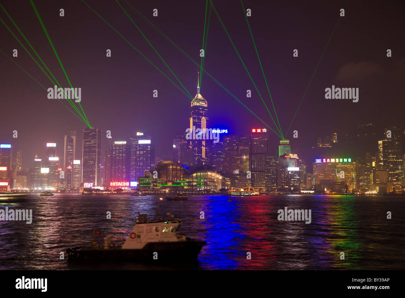 Laser light show Hong Kong Island at night viewed across Victoria Harbour from Kowloon. JMH4152 - Stock Image