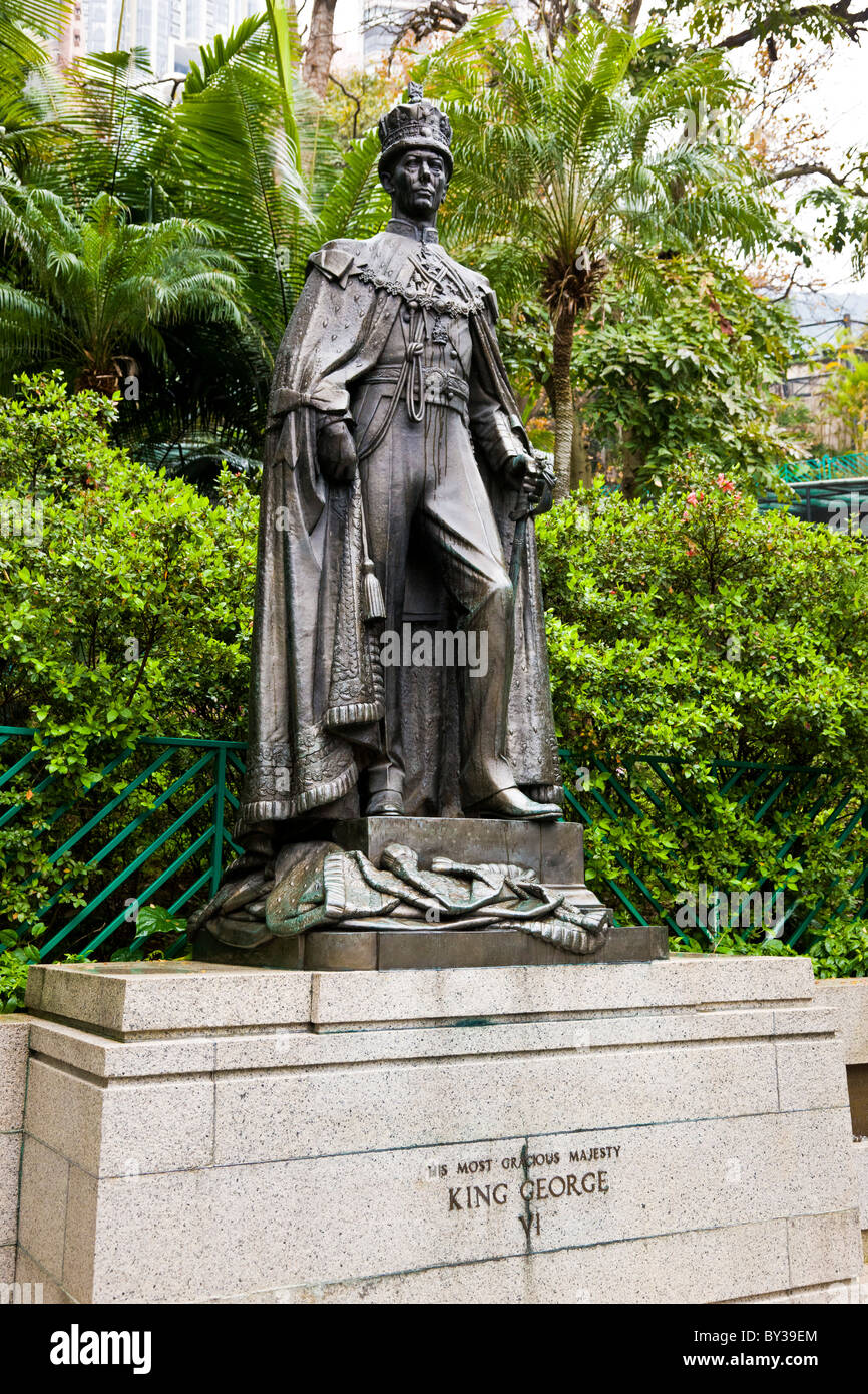 Statue of 'His Most Gracious Majesty King George VI' in the Zoological and Botanical Gardens Hong Kong. - Stock Image