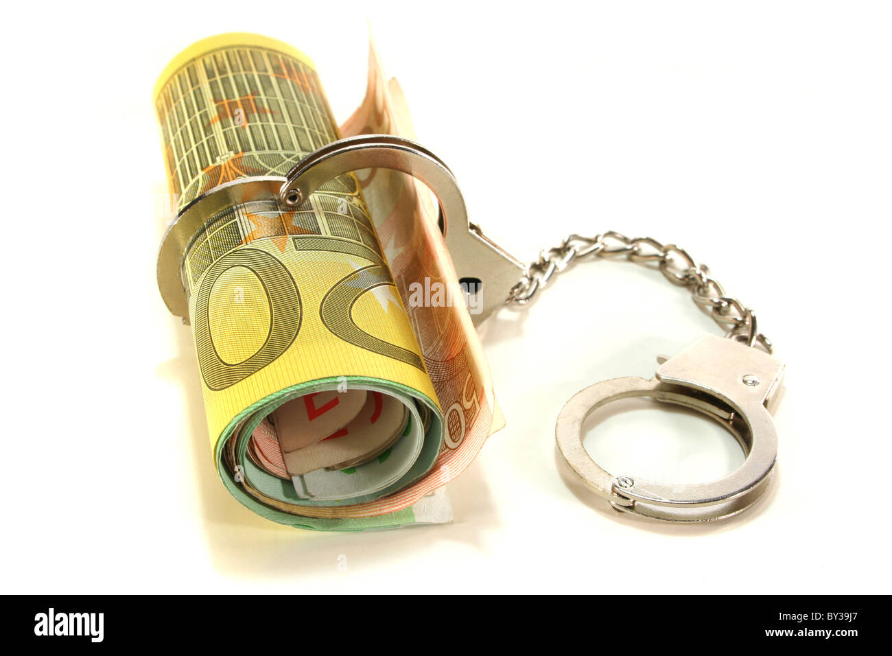 Euro notes with handcuffs on a white background - Stock Image