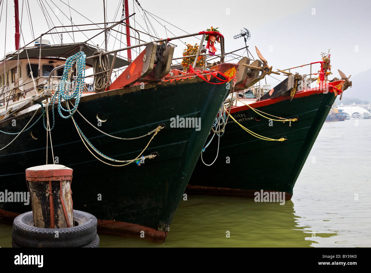 Fishing boats tied up in harbour Macau SAR People's Republic of China. JMH4161 - Stock Image