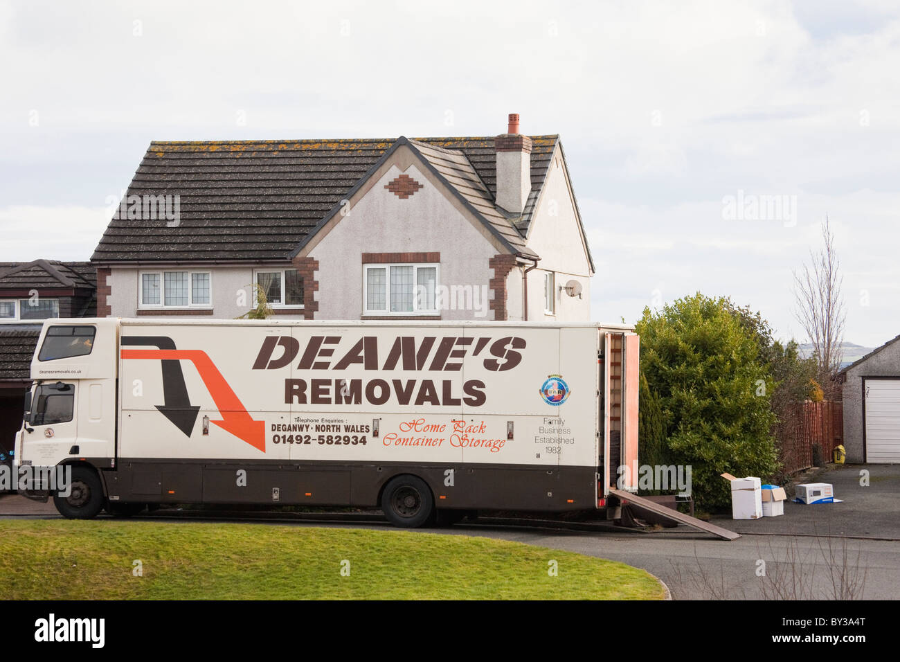 Furniture Removal Van In The Street Outside A House For Home Removals.  North Wales, UK, Britain.
