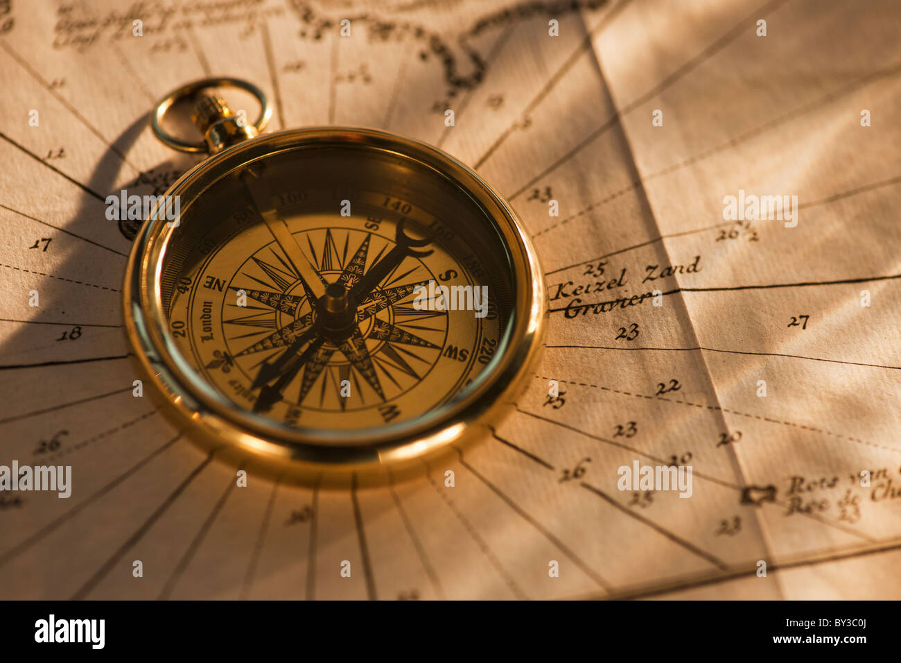 Compass on map - Stock Image