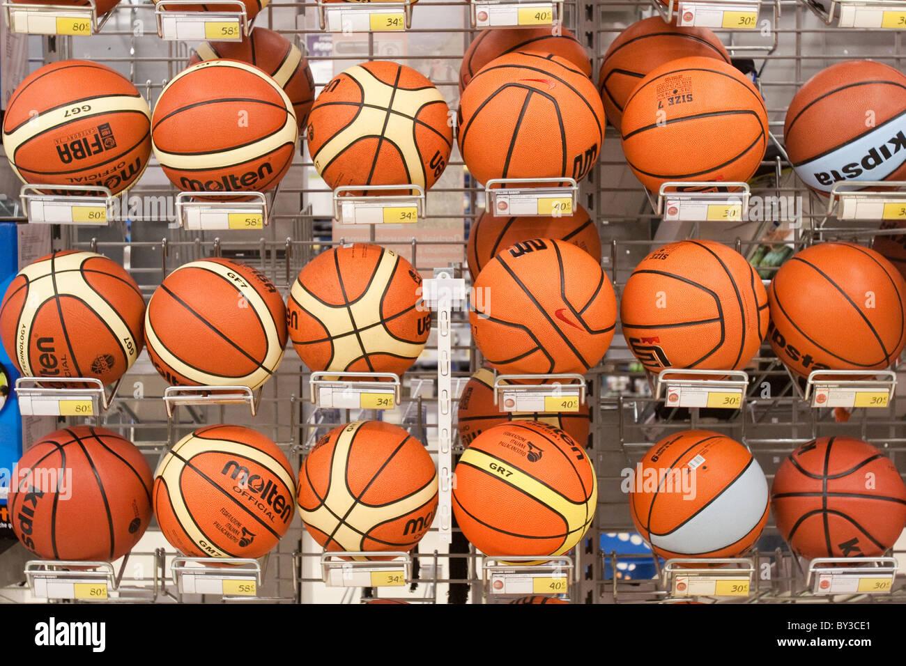 Basketball balls displayed shelves