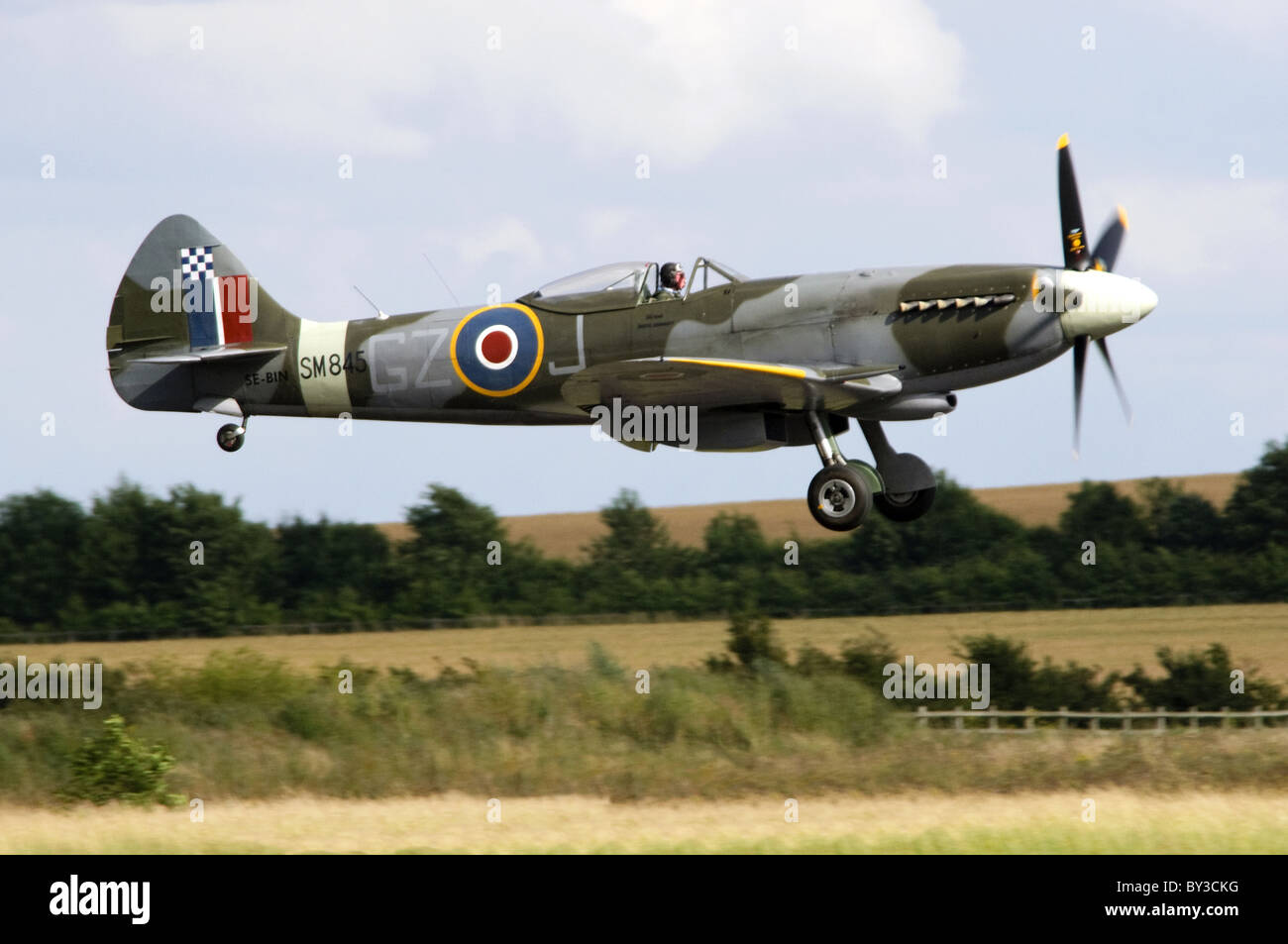 Supermarine Spitfire FR.XVIIIe in RAF camouflage landing after displaying at Duxford Flying Legends Airshow Stock Photo