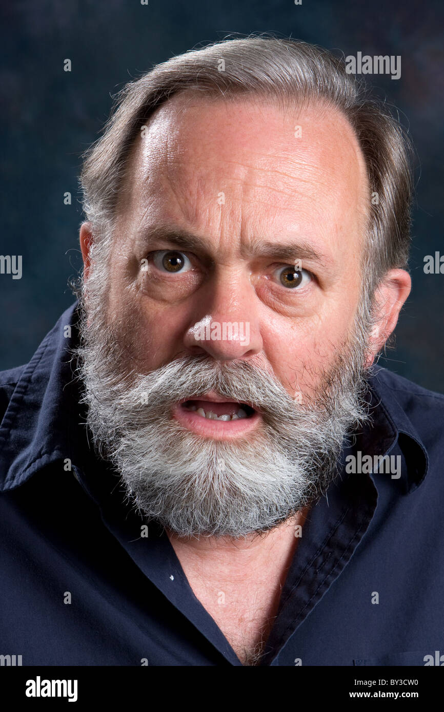 Emotionally charged man confronts with his feelings of injustice. - Stock Image