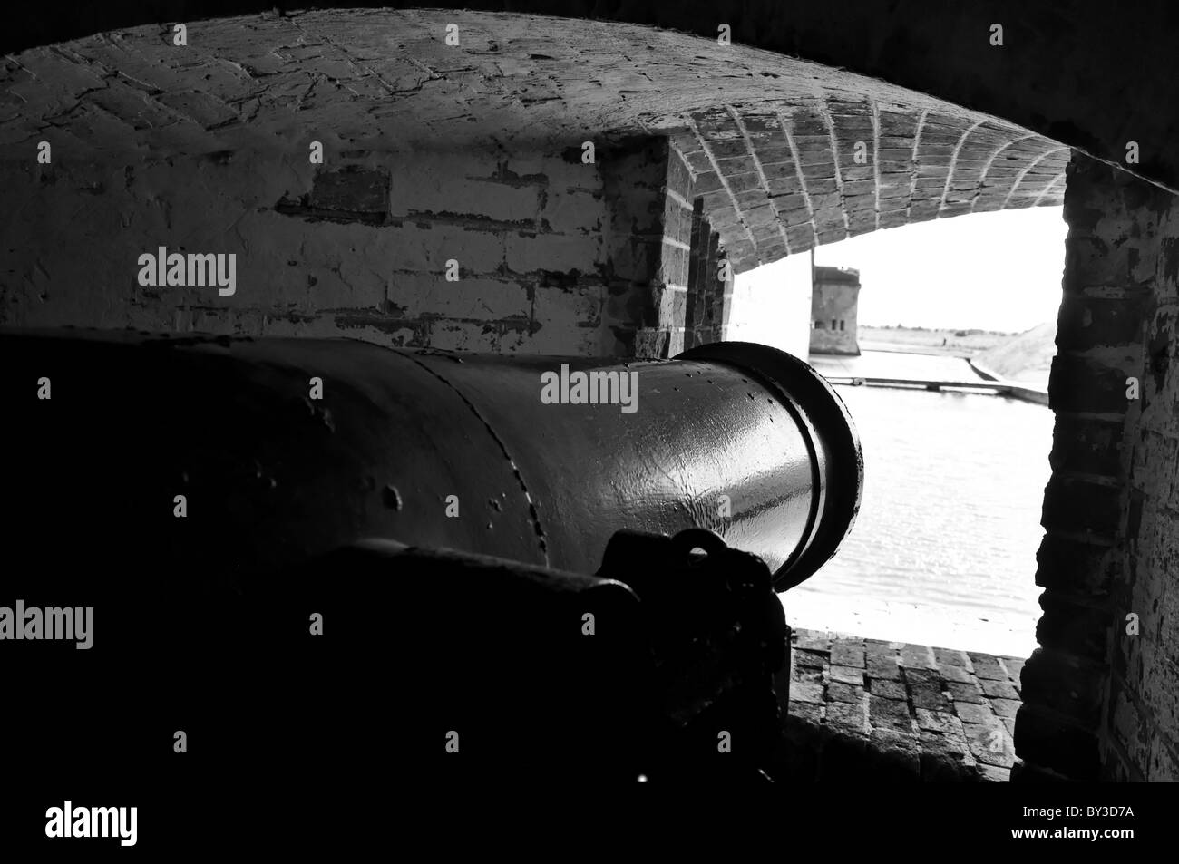 Canon pointing in direction of moat at Fort Pulaski in Savannah, Georgia. - Stock Image
