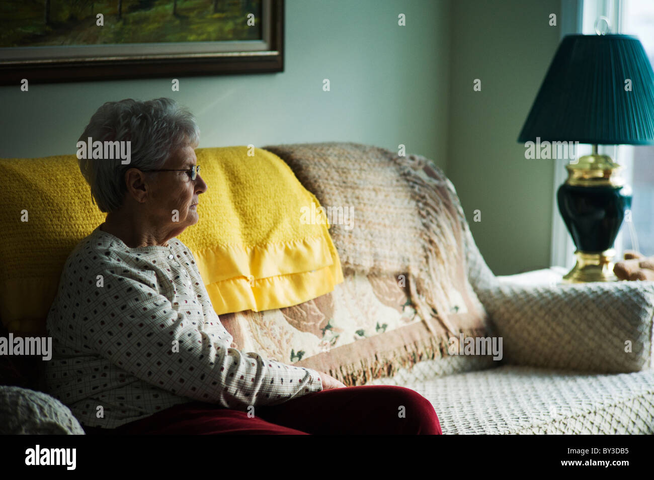 Old Woman Sits Alone On Couch Stock Photo 33882441 Alamy