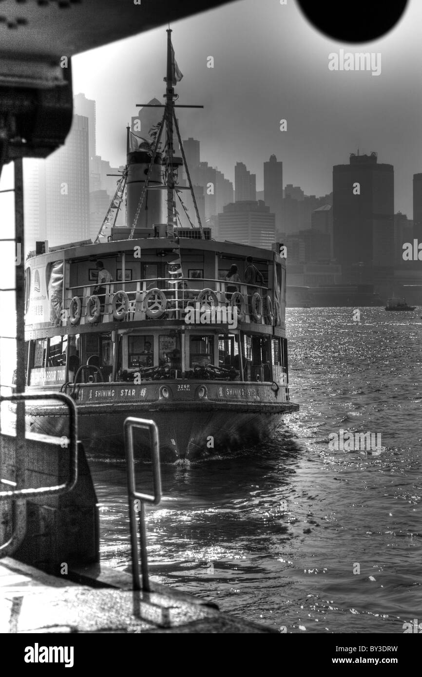 The Star Ferry, one of the must-do's in Hong Kong, has been running for about a century.  It is a leisurely - Stock Image