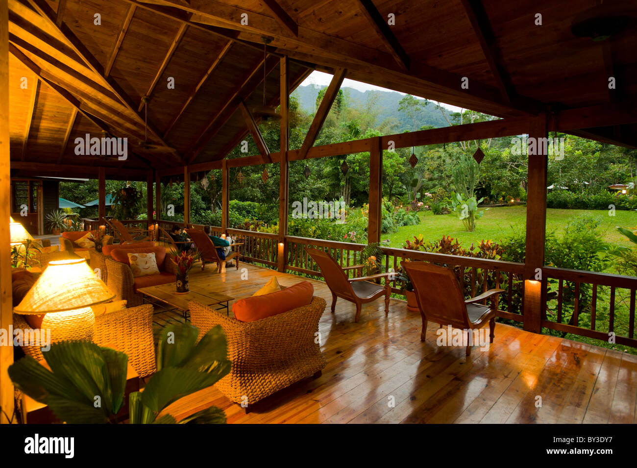 The Veranda at The Lodge at Pico Bonito, La Ceiba, Hounduras where guests can sit and observe the tropical gardens - Stock Image