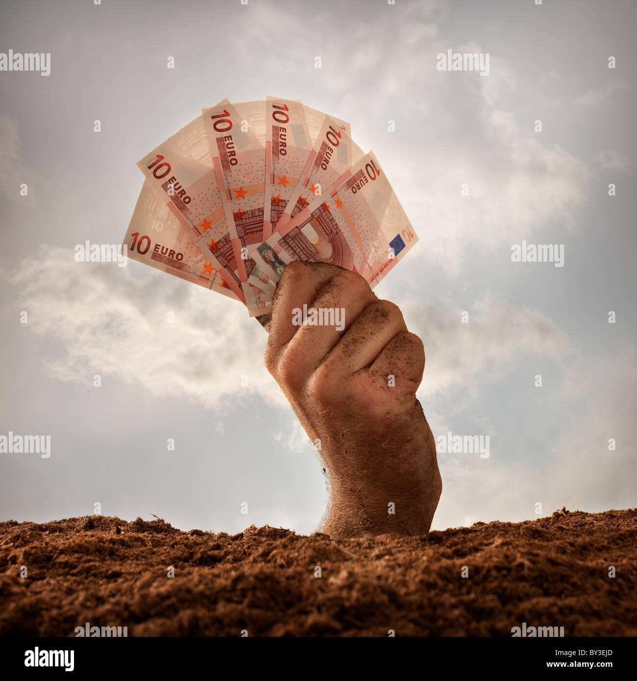 Human hand holding ten euros banknotes, studio shot - Stock Image