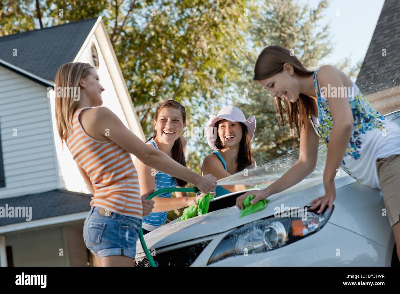 Young Girls Washing Cars