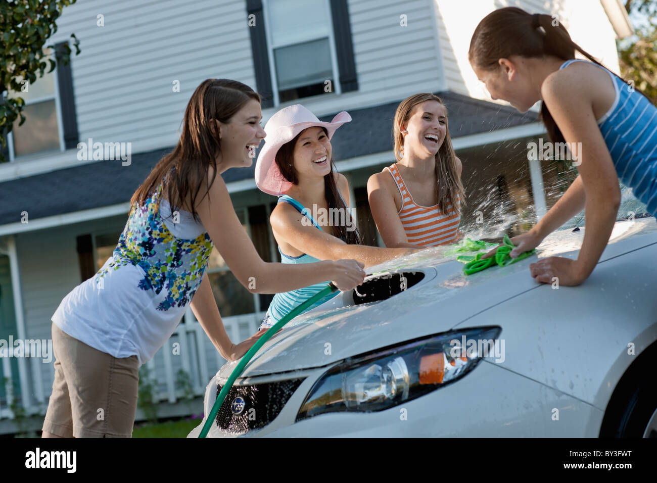 young-teen-girl-on-car