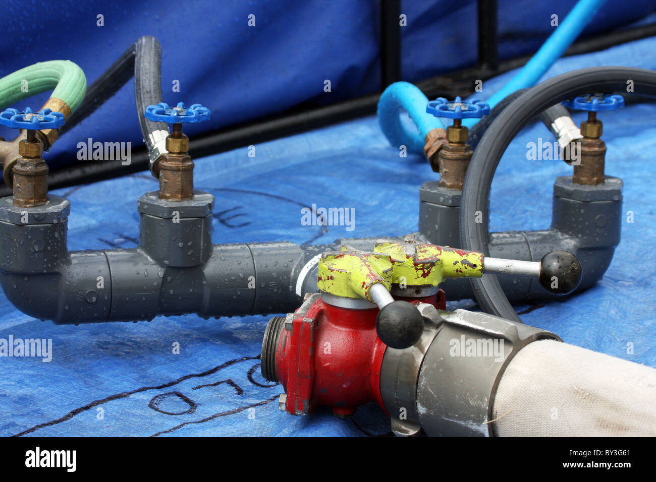 Valves on a hose line in a tub for chemical washoff from a hazardous ...