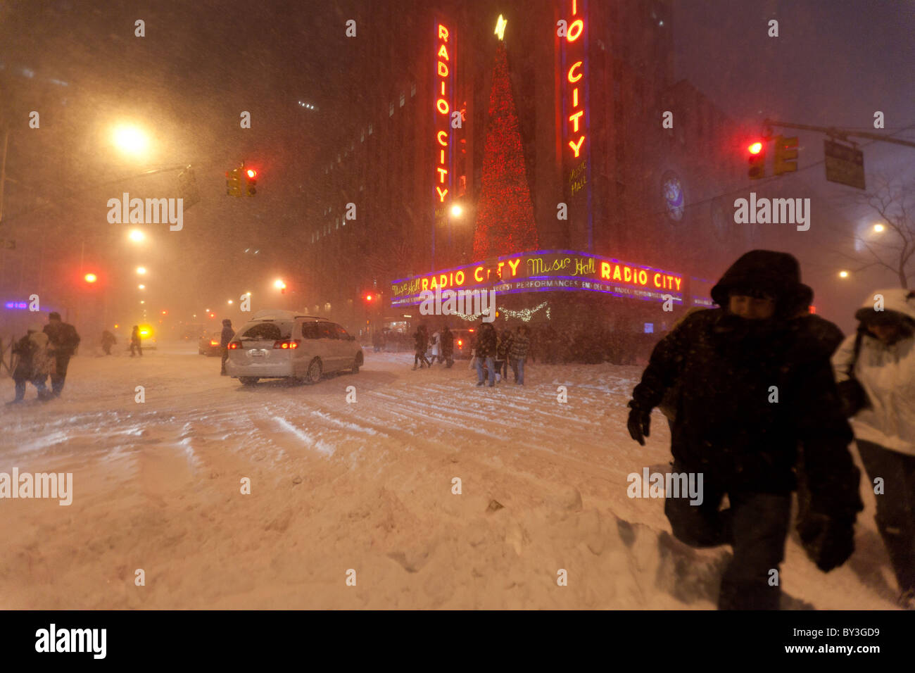 People leaving Radio city music hall Christmas show in heavy snowfall in Christmas 2010 Stock Photo