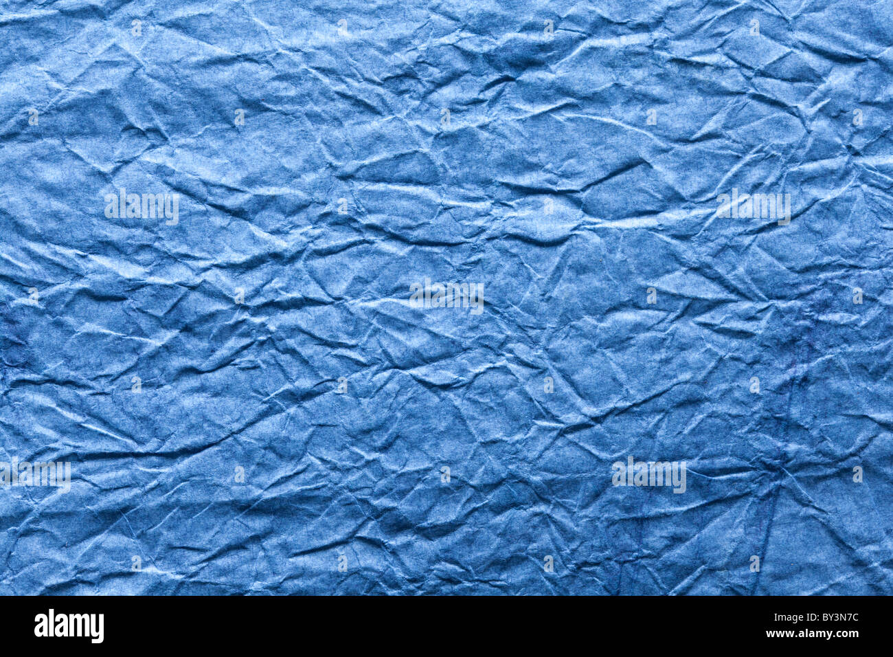 Image texture of crumpled blue paper. - Stock Image