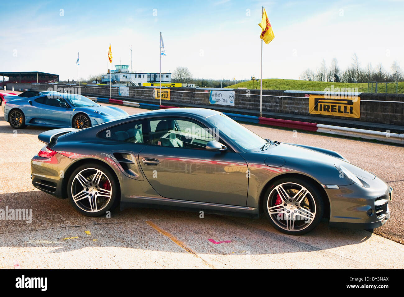 Side view of porsche sports car at Thruxton racing circuit - Stock Image