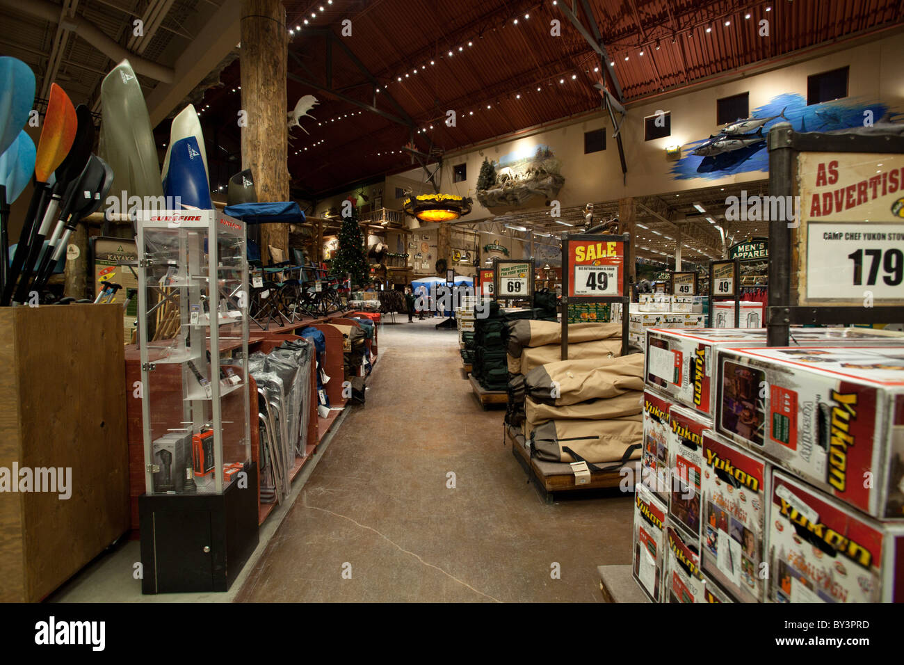 Boat and camping equipment for sale in Outdoor World retail store in Stock Photo: 33889841 - Alamy