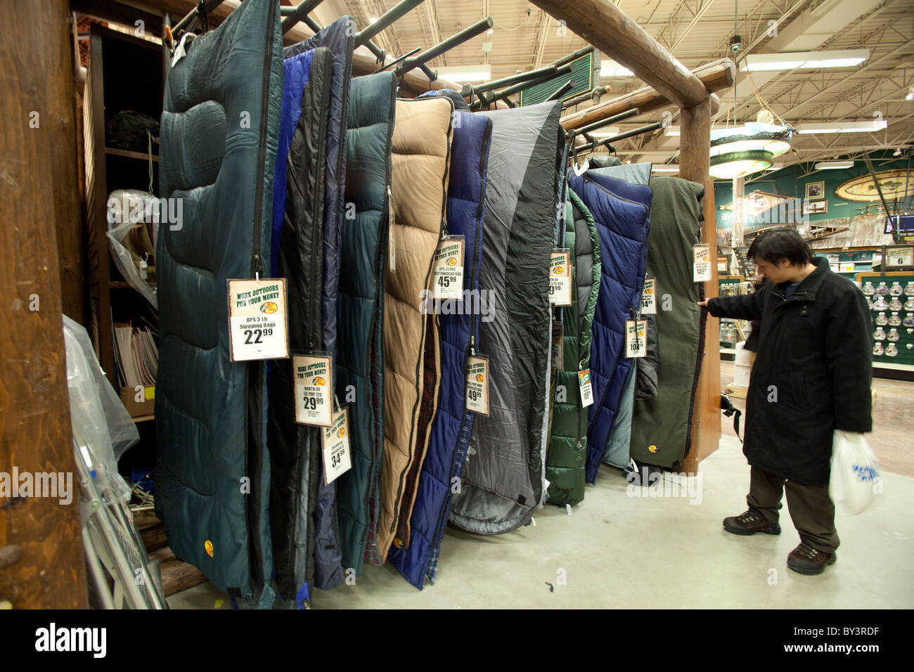 new york 1c468 38ab6 A man checking out sleeping bags in Outdoor World retail ...