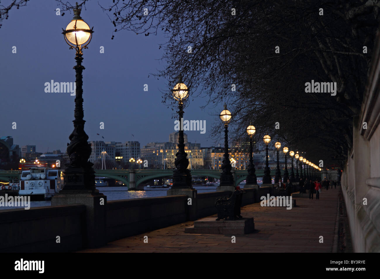 South Bank by lamp light Thames embankment London path evening walk - Stock Image