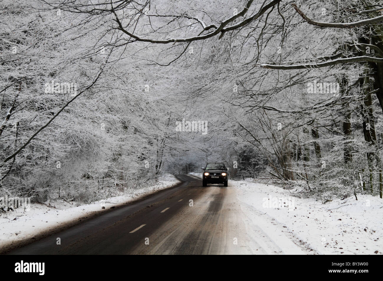 Winter driving country road hazardous conditions icy frosty - Stock Image