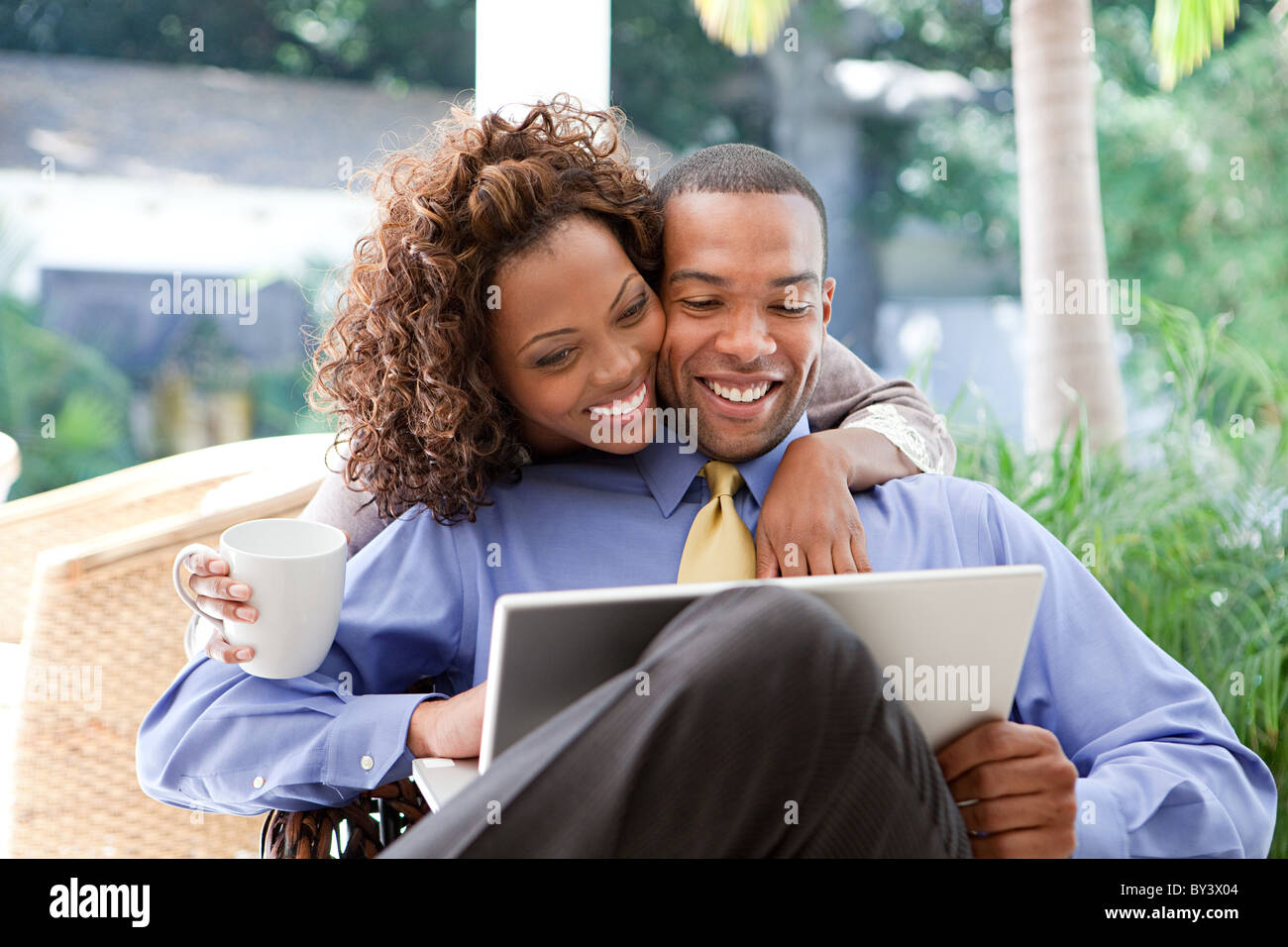 Young couple with laptop - Stock Image