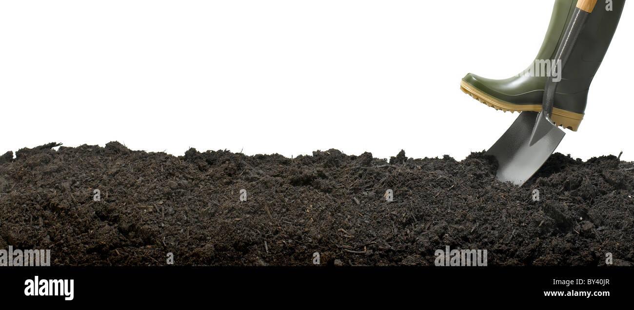 spade digging soil - Stock Image