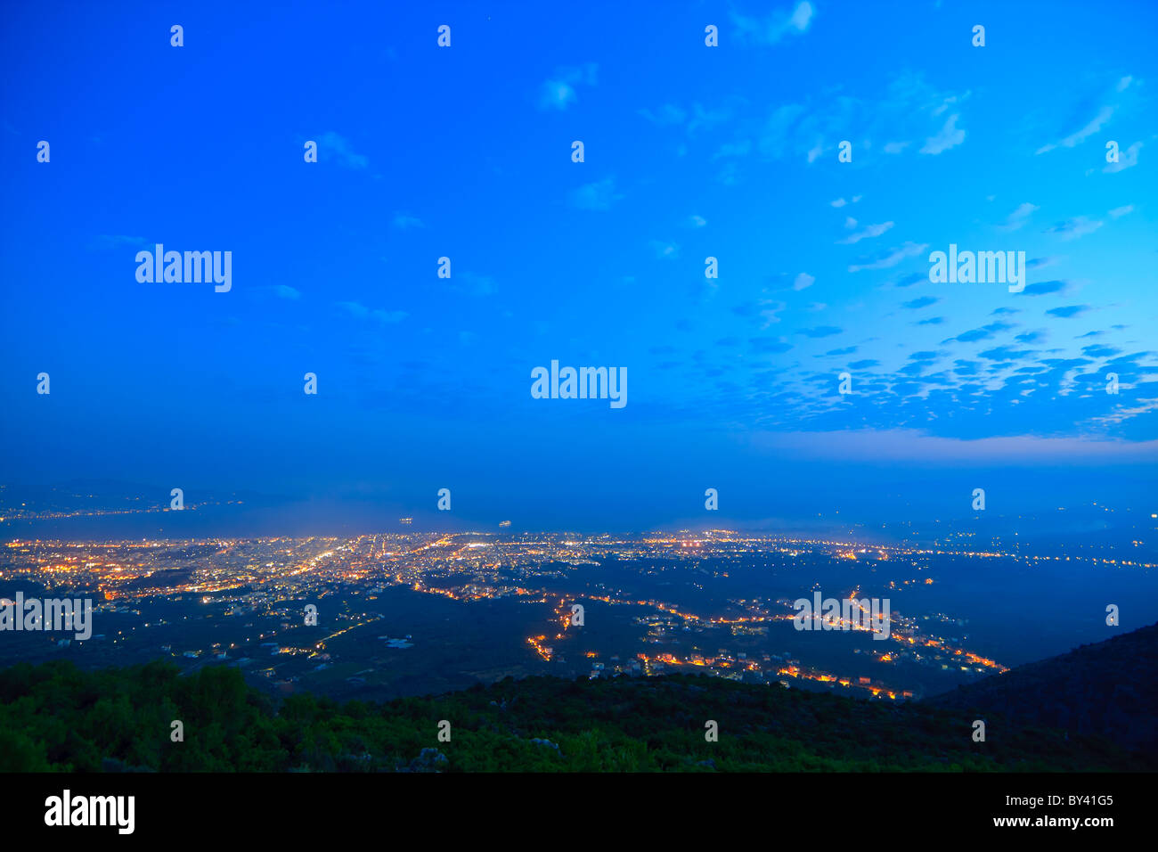 Greek city skyline at blue hour - Stock Image