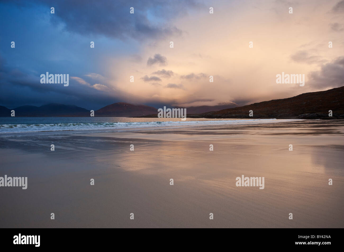 Rain clouds at sunset over Luskentyre beach, Isle of Harris, Outer Hebrides, Scotland Stock Photo