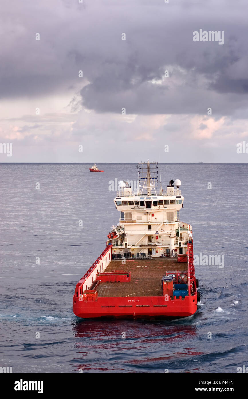 North Sea supply vessel supporting offshore operations within the oil and gas industry - Stock Image