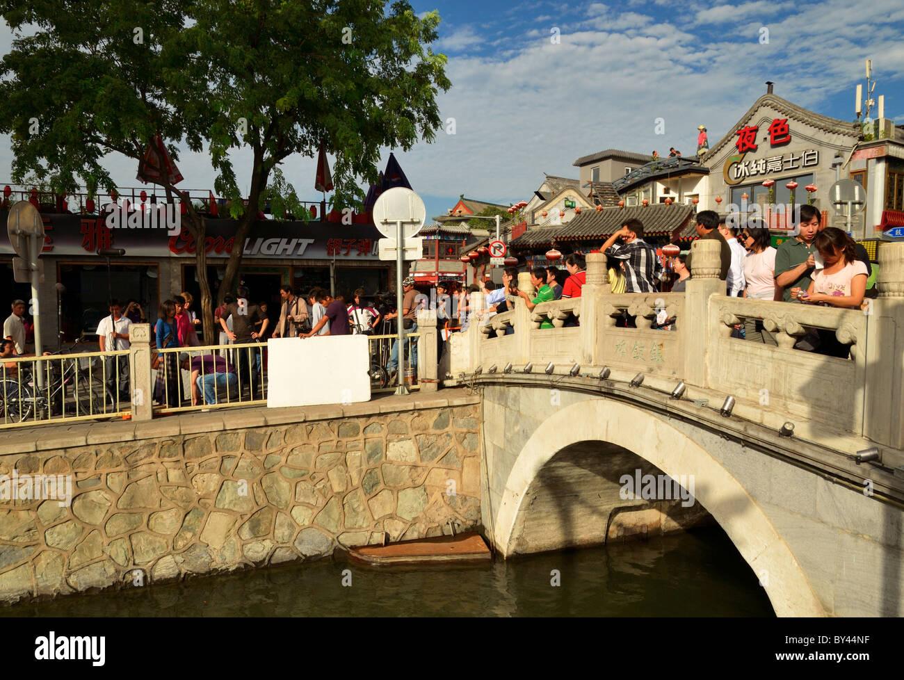 Jin Dynasty Yinding bridge near lake Qianhai and Lake Houhai in the Shichahai district of Beijing, China CN - Stock Image