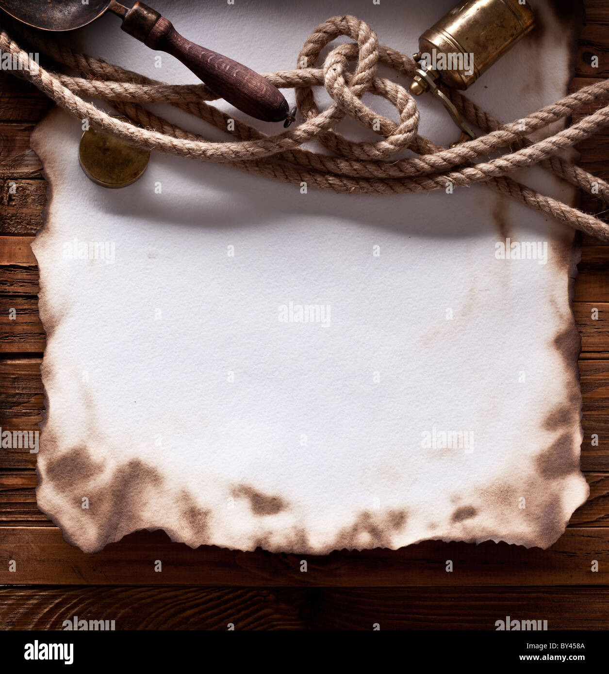 Image of old paper on a wooden board. - Stock Image